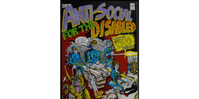 "A photograph of the front cover of a comic book. In bold, purple, green and orange text it says, ""Anti-Social for the Disabled"". The text, ""Disabled"" is larger with a curvy font. Beneath the title is a drawing of four middle-aged people in blue jumpsuits. They are busting through a red brick building in a car. The person in the center is wearing yellow-tinted glasses. On the bottom right, a wolf with large teeth has its jaw extended. The man on the right is shooting a laser."