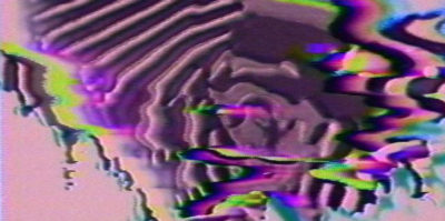 A video still of a 1976 video. The video design is of a blurred, abstracted cloud-like form with ripples, cuts, and lines. The background is a light pink color, and the design is a blended assortment of colors shades of purple, green, and blue. The left side of the design has softer, lighter ripples with muted tones of the colors. On the right side of the design, the ripples are more vivid and are darker in tones.
