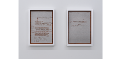 Two separate pieces of onion paper held with teak backings juxtaposed together. It is about the length of an arm. The two papers have a profile information of Vietnamese anti-colonialist Minh Khai in French with a red typewriter font, including the artist's handwritten English notes beside.