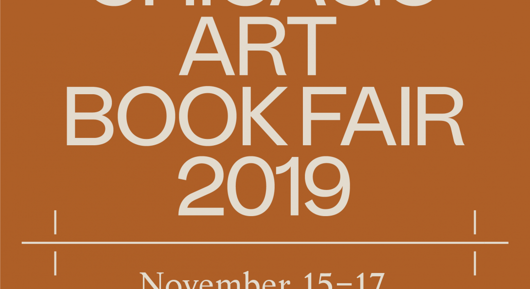 """Large white letters overtop an orange brown background. The letters write """"Art Bookfair 2019"""""""