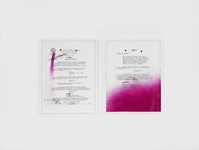 Two pieces of paper with type-writing (archival FBI documents on Rodney Barnette) sit side by side against a white backdrop. Portions of the papers are covered with glitter and purple spray paint.